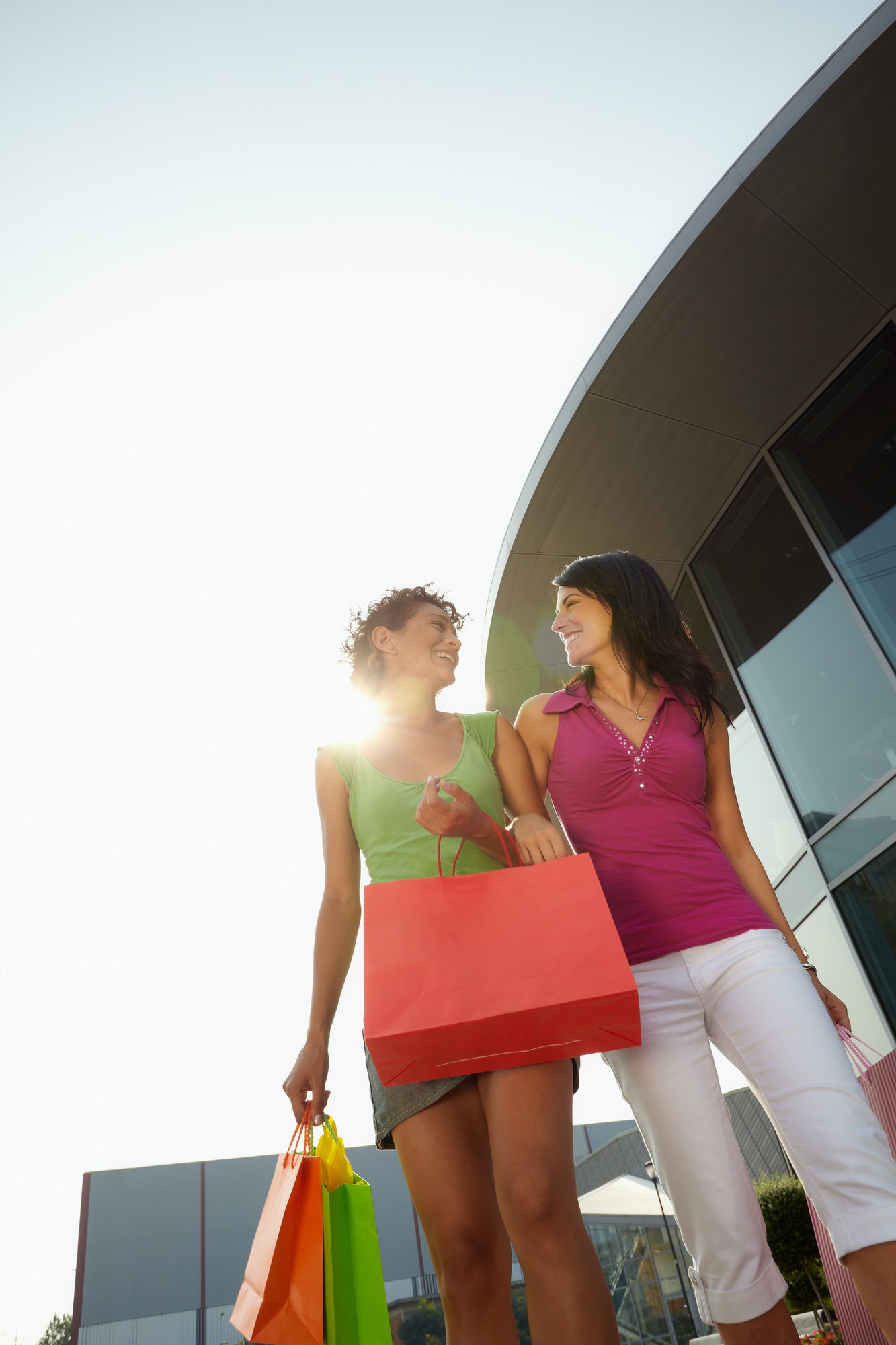 Female Friends With Shopping Bags